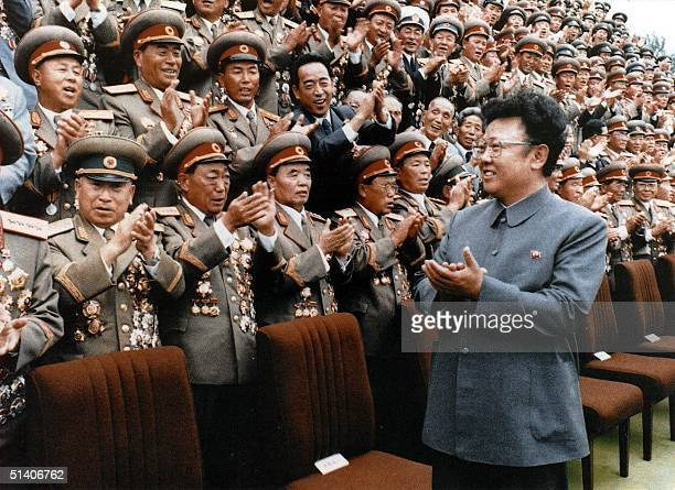 North Korean leader Kim Jong-Il meets with Korean People's Army personnel in September 1988 file photo. Kim Jong-Il was re-elected as head of the...