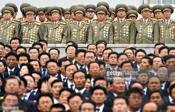 Koreans in business suits and military outfits attend a parade at Kim Il Sung Square in Pyongyang North Korea on May 1 2016 The parade and...