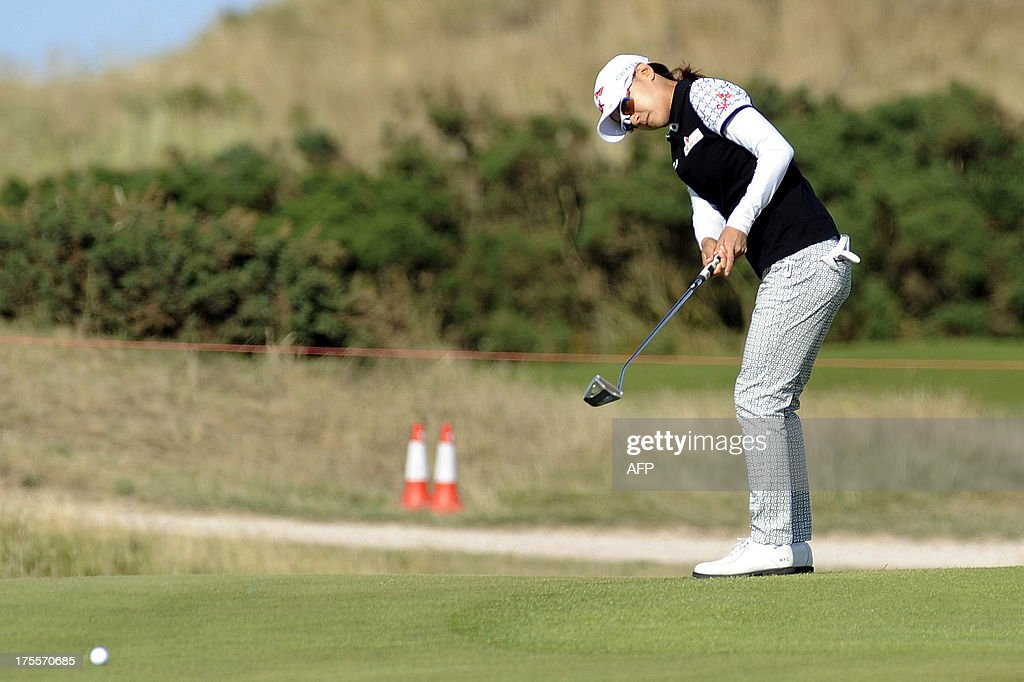 Korea's Choi Na Yeon putts on the 13th green during the final round of the Women's British Open Golf Championship at the Old Course in St Andrews, Scotland, on August 4, 2013. US golfer Stacy Lewis won the women's British Open on Sunday by two shots. Lewis, the winner of the 2011 Kraft Nabisco Championship, collected her second major with a final round 72 for an eight-under-par total of 280.