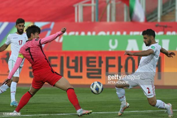 Korea's forward Son Heung-min vies for the ball with Iran's defender Sadegh Moharrami during the 2022 Qatar World Cup Asian Qualifiers football match...