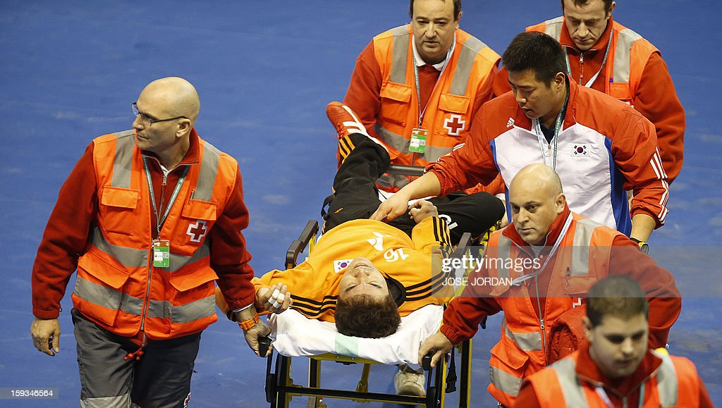 Korea's goalkeeper Il-Koo Kang is stretched out during the 23rd Men's Handball World Championships preliminary round Group C match Serbia vs Korea at the Pabellon Principe Felipe in Zaragoza on January 12, 2013.