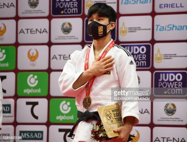 Korea's gold medallist Baul An stands on the podium of the men -66kg category of the Tashkent Grand Slam judo tournament at the Humo Arena in...