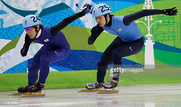 Korea's Lee HoSuk leads USA's Simon Cho in the Men's 500 Meter qualifying heats during the 2010 Winter Olympics in Vancouver British Columbia...