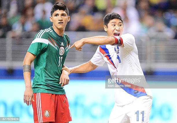 Korea's Lee KeunHo shouts instructions while holding on to Mexico's Alan Pulido during a friendly soccer match between the Mexico National Team and...