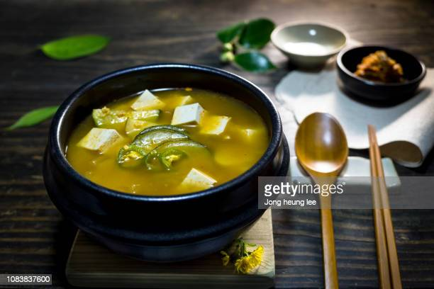 korea's representative food,soybean paste stew(doenjang jjigae) and kimchi - jong heung lee stock pictures, royalty-free photos & images