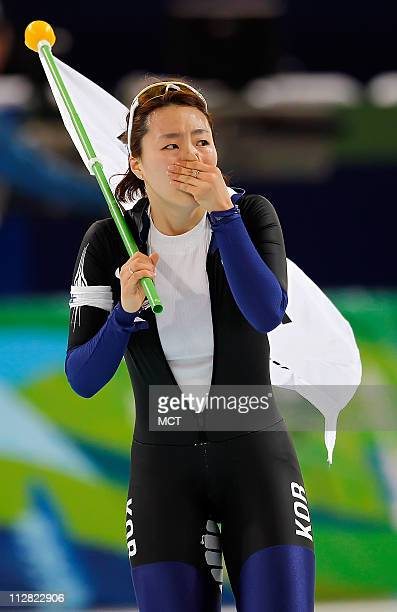 Korea's SangHwa Lee cry's while circling the track after winning the Goal Medal in the 500 Meter Ladies Speed Skating event during the 2010 Winter...