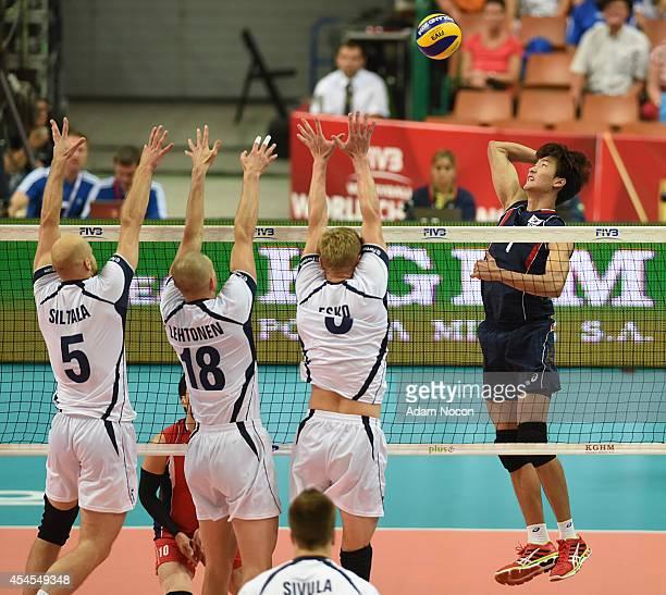 Korea's Song Myunggen attacks against Antti Siltala, Jukka Lehtonen, Mikko Esko, during the FIVB World Championships match between Finland v Korea on...