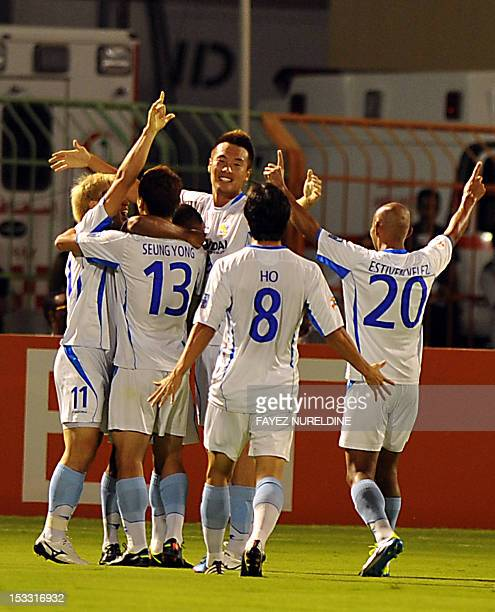 Korea's Ulasn Hyundai players celebrate after scoring the second goal against Saudi's alHilal club during their quarterfinal football match in the...