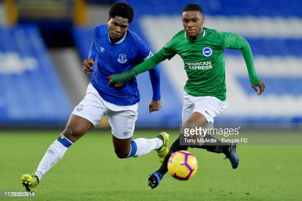 Korede Adedoyin of Everton challenges for the ball with Ayo Tanimowoduring the FA Youth Cup match between Everton and Brighton Hove Albion at...
