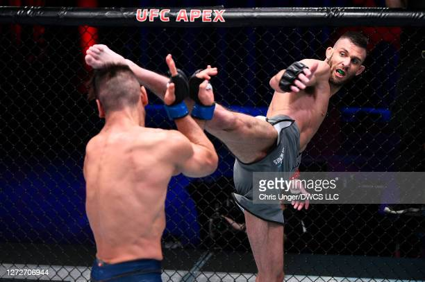 Korey Kuppe kicks Michael Lombardo in their welterweight bout during week seven of Dana White's Contender Series season four at UFC APEX on September...