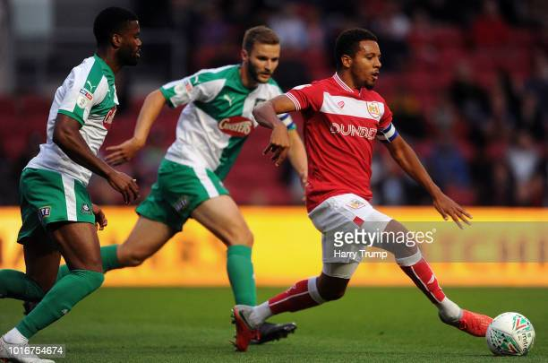 Korey Smith of Bristol City attempts a pass under pressure from Joel grant of Plymouth Argyle during the Carabao Cup First Round match between...
