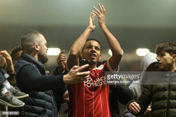 Korey Smith of Bristol City celebrates with fans at the end of the Carabao Cup QuarterFinal match between Bristol City and Manchester United at...