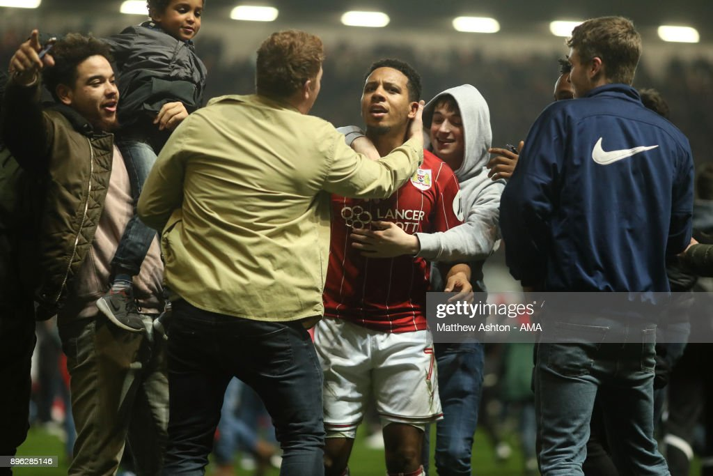 Korey Smith of Bristol City celebrates with fans at the end of the Carabao Cup Quarter-Final match between Bristol City and Manchester United at Ashton Gate on December 20, 2017 in Bristol, England.