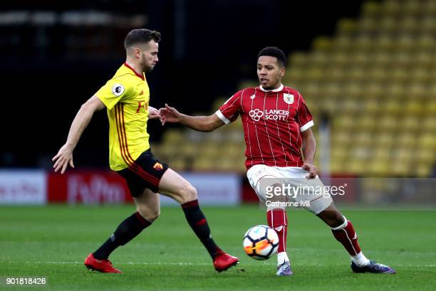 Korey Smith of Bristol City is closed down by Tom Cleverley of Watford during The Emirates FA Cup Third Round match between Watford and Bristol City...