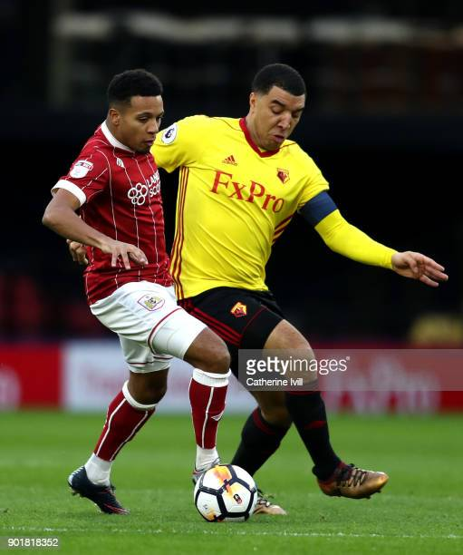 Korey Smith of Bristol City is closed down by Troy Deeney of Watford during The Emirates FA Cup Third Round match between Watford and Bristol City at...