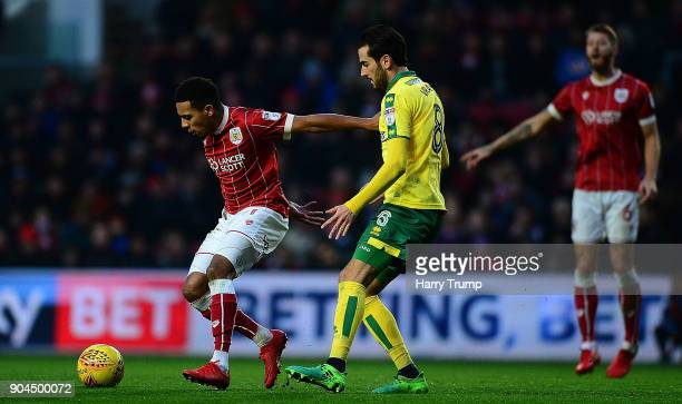 Korey Smith of Bristol City is tackled by Mario Vrancic of Norwich City during the Sky Bet Championship match between Bristol City and Norwich City...