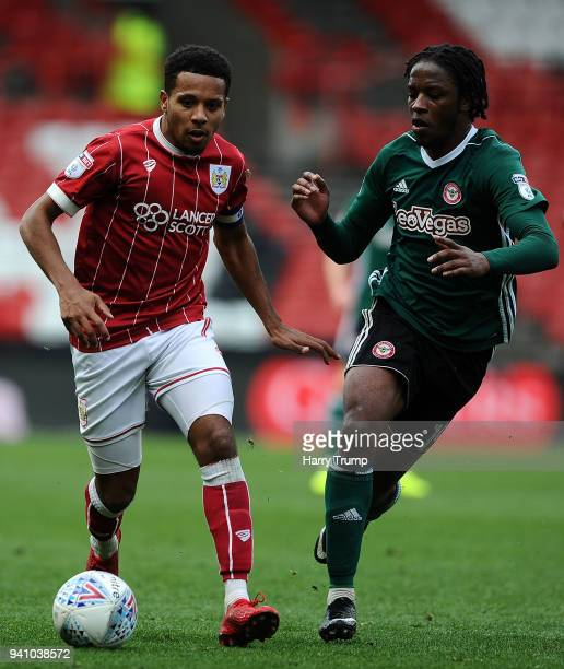 Korey Smith of Bristol City is tackled by Romaine Sawyers of Brentford during the Sky Bet Championship match between Bristol City and Brentford at...
