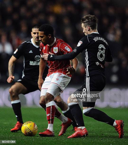 Korey Smith of Bristol City looks to break past Stefan Johansen of Fulham during the Sky Bet Championship match between Bristol City and Fulham at...