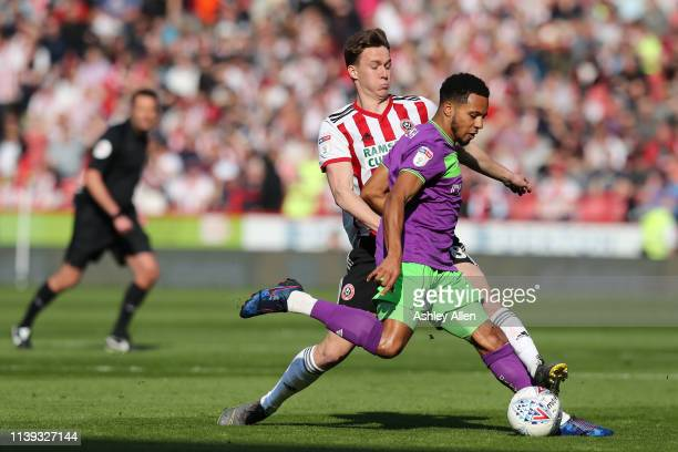 Korey Smith of Bristol City passes the ball on as Kieran Dowell of Sheffield United challenges at Bramall Lane during the Sky Bet Championship match...