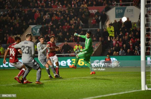 Korey Smith of Bristol City scores his sides second goal past Sergio Romero of Manchester United during the Carabao Cup QuarterFinal match between...