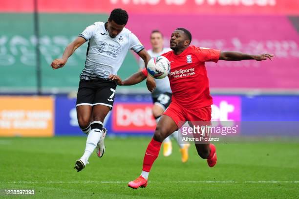 Korey Smith of Swansea City battles with Jérémie Bela of Birmingham City during the Sky Bet Championship match between Swansea City and Birmingham...