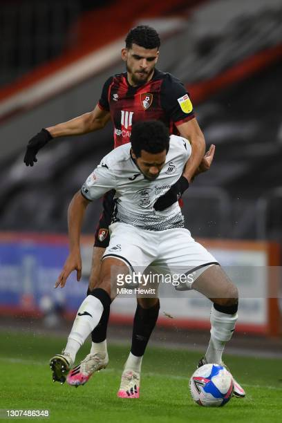 Korey Smith of Swansea City is challenged by Dominic Solanke of Bournemouth during the Sky Bet Championship match between AFC Bournemouth and Swansea...