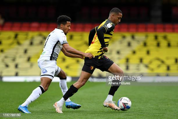 Korey Smith of Swansea City vies for possession with João Pedro of Watford during the Sky Bet Championship match between Watford and Swansea City at...