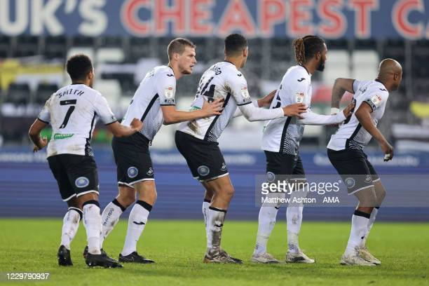 Korey Smith, Ryan Bennett, Ben Cabango, Kasey Palmer and Andre Ayew of Swansea City line up for a corner during the Sky Bet Championship match...