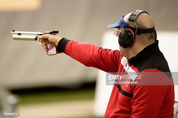 Korhan Yamac of Turkey competes in the Men's P1-10m Air Pistol SH1 Finals on day 1 of the London 2012 Paralympic Games at The Royal Artillery...