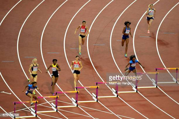 Kori Carter and Dalilah Muhammad of the United States jump a hurdle during the womens 400 metres hurdles final during day seven of the 16th IAAF...