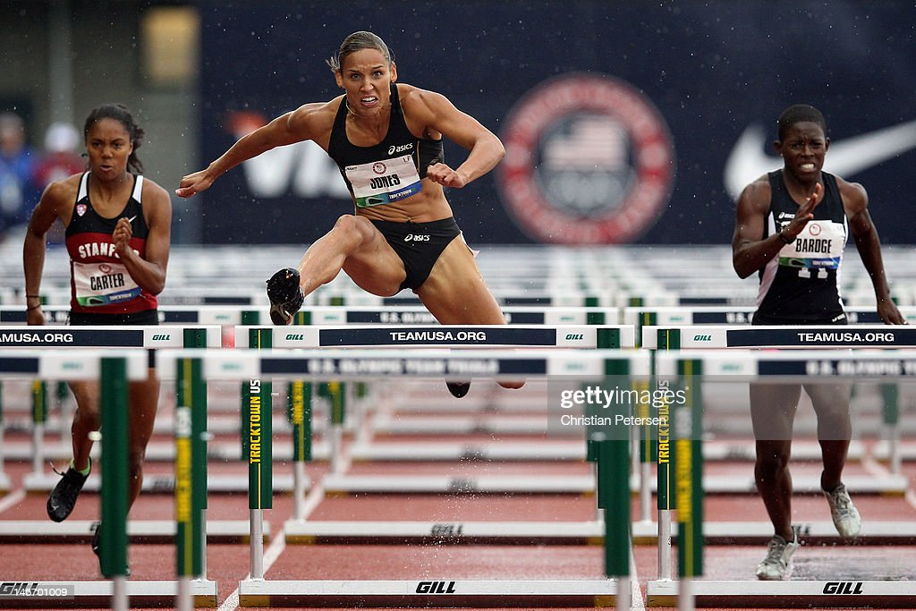 Kori Carter, Lolo Jones and Crystal Bardge compete in a preliminary round of women's 100 meter hurdles during Day One of the 2012 U.S. Olympic Track & Field Team Trials at Hayward Field on June 22, 2012 in Eugene, Oregon.