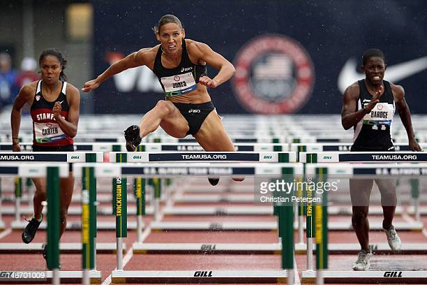 Kori Carter Lolo Jones and Crystal Bardge compete in a preliminary round of women's 100 meter hurdles during Day One of the 2012 US Olympic Track...