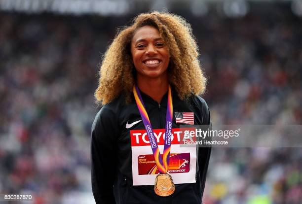 Kori Carter of the United States gold poses with her medal for the Women's 400 metres hurdles during day eight of the 16th IAAF World Athletics...