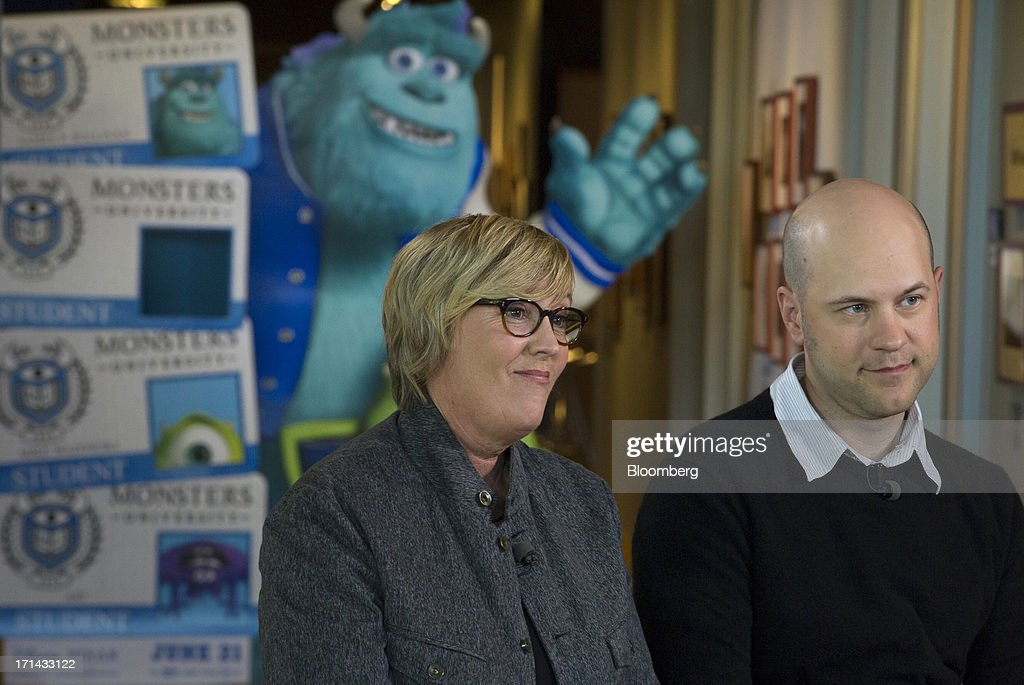 Kori Rae, producer of the Pixar movie 'Monsters University', left, and Dan Scanlon, director of the Pixar movie 'Monsters University', listen during a Bloomberg West Television interview at the Pixar Animation Studios headquarters in Emeryville, California, U.S., on Friday, June 21, 2013. Walt Disney Co.s Pixar animation 'Monsters University' took first place at U.S. and Canadian theaters this past weekend with $82 million in ticket sales, overcoming Brad Pitts zombie apocalypse tale 'World War Z,' which was second with $66 million. Photographer: David Paul Morris/Bloomberg via Getty Images