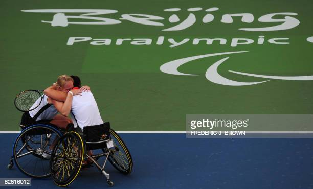 Korie Homan and Sharon Walraven of the Netherlands hug each other after winning gold against compatriots Jiske Griffioen and Esther Vergeer in the...
