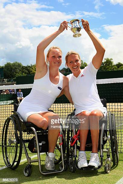 Korie Homan of Netherlands celebrates with Esther Vergeer of Netherlands celebrate victory after the wheelchair ladies' doubles final match against...