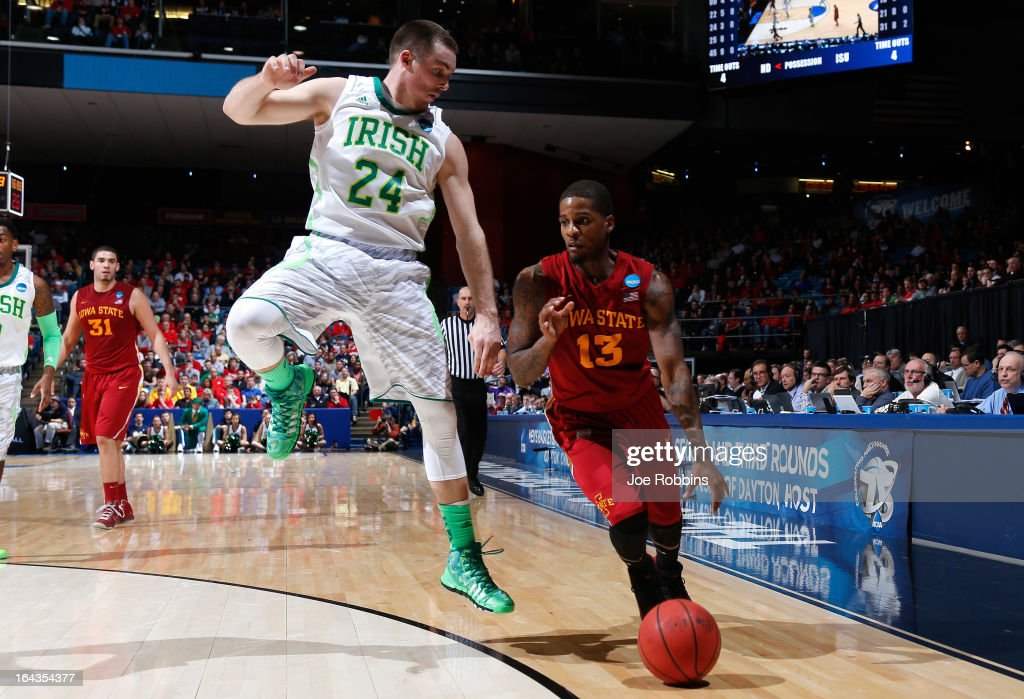 Korie Lucious #13 of the Iowa State Cyclones dribbles against Pat Connaughton #24 of the Notre Dame Fighting Irish in the second half during the second round of the 2013 NCAA Men's Basketball Tournament at UD Arena on March 22, 2013 in Dayton, Ohio.
