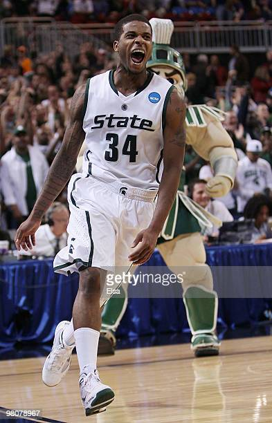 Korie Lucious of the Michigan State Spartans celebrates the win during the midwest regional semifinal of the 2010 NCAA men's basketball tournament at...