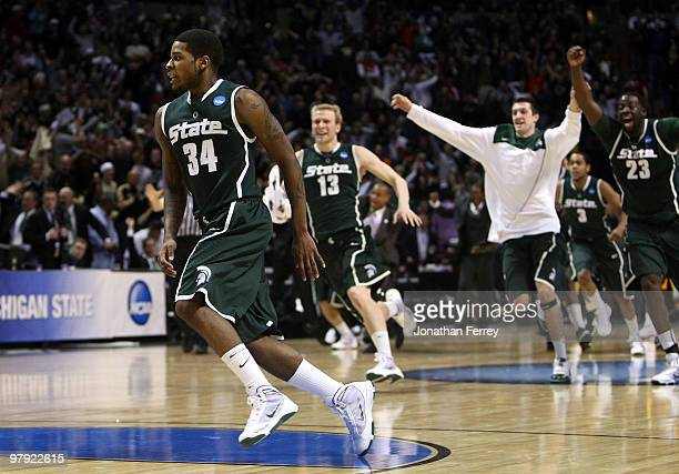 Korie Lucious of the Michigan State Spartans celebrates with his teammates after sinking a game winning three point shot at the buzzer to win 85-83...