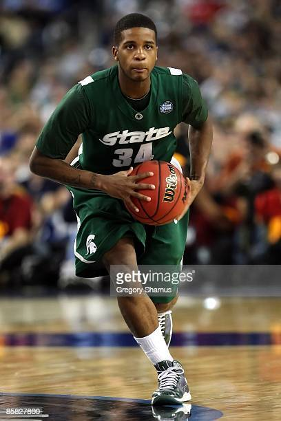 Korie Lucious of the Michigan State Spartans looks to pass the ball against the Connecticut Huskies during the National Semifinal game of the NCAA...