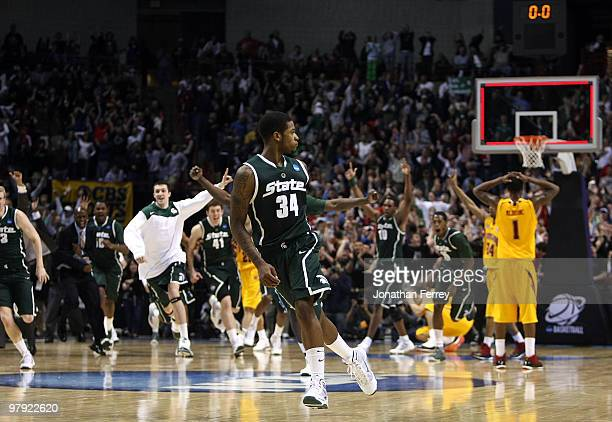 Korie Lucious of the Michigan State Spartans runs down the court after sinking a game winning three point shot at the buzzer to win 85-83 against the...