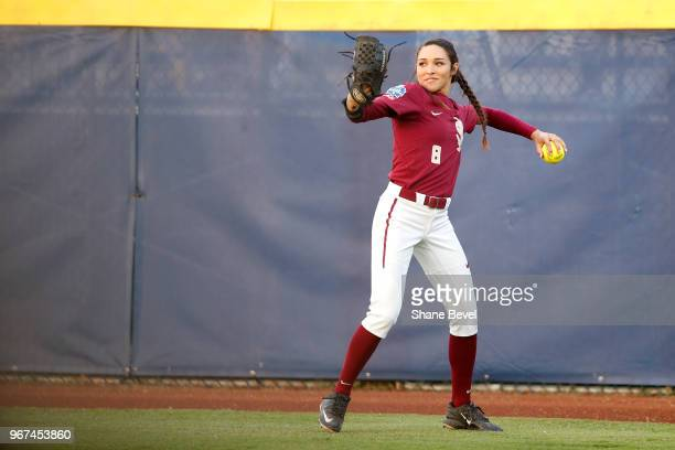 Korina Rosario of the Florida State Seminoles makes a throw from right field against the Washington Huskies during the Division I Women's Softball...