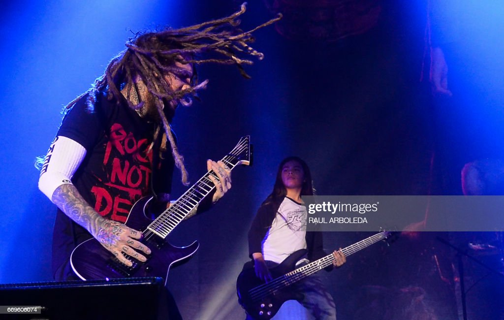 Korn's band Brian 'Head' Welch (L) and 12-year-old Tye Trujillo, son of Metallica's bassist Robert Trujillo perform in Bogota on April 17, 2017, /