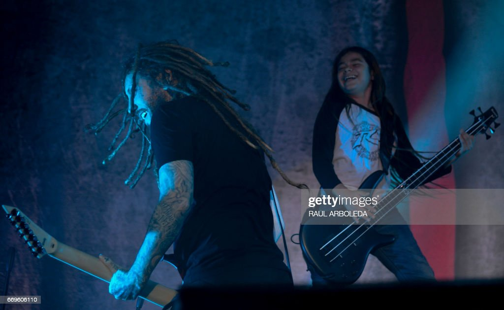 Korn's band Brian 'Head' Welch (L) and band 12-year-old Tye Trujillo, son of Metallica's bassist Robert Trujillo performs in Bogota on April 17, 2017, /