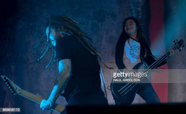 Korn's band Brian Head Welch and band 12yearold Tye Trujillo son of Metallica's bassist Robert Trujillo performs in Bogota on April 17 / AFP PHOTO /...