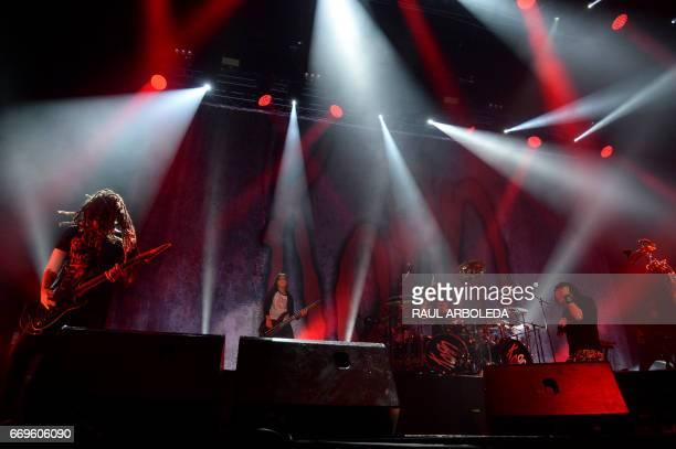 Korn's band Brian Head Welch Jonathan Davis and 12yearold Tye Trujillo son of Metallica's bassist Robert Trujillo perform in Bogota on April 17 / AFP...