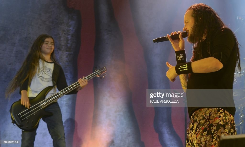 Korn's band Jonathan Davis (R) and 12-year-old Tye Trujillo, son of Metallica's bassist Robert Trujillo perform in Bogota on April 17, 2017, /