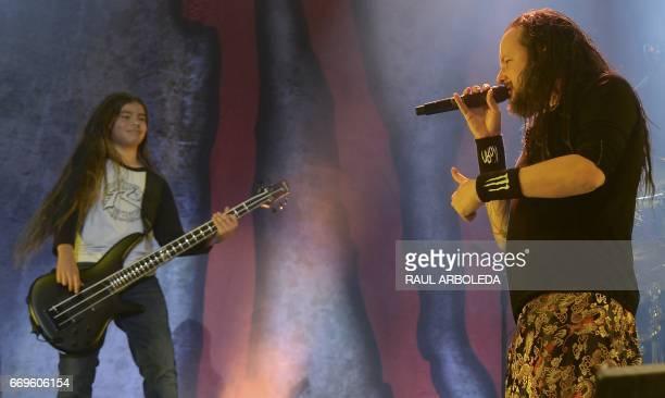 Korn's band Jonathan Davis and 12yearold Tye Trujillo son of Metallica's bassist Robert Trujillo perform in Bogota on April 17 / AFP PHOTO / RAUL...