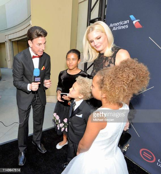 Korros talks with Jennifer Lucas and children at Byron Allen Honored by Los Angeles Urban League on April 18 2019 in Hollywood California