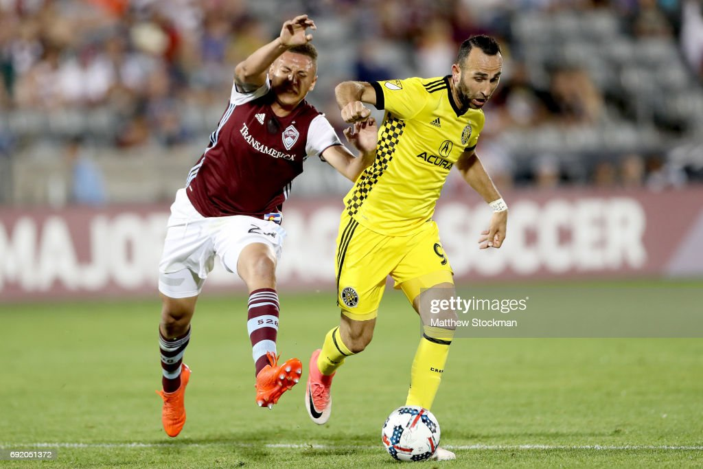 Kortne Ford #24 of the Colorado Rapids battles for the ball against Justin Meram of Columbus Crew SC at Dick's Sporting Goods Park on June 3, 2017 in Commerce City, Colorado.